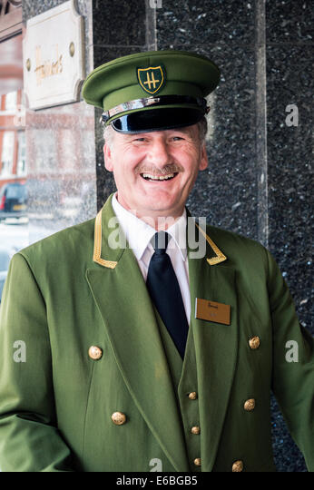 Doorman opening door stock photos doorman opening door for Door 4 harrods