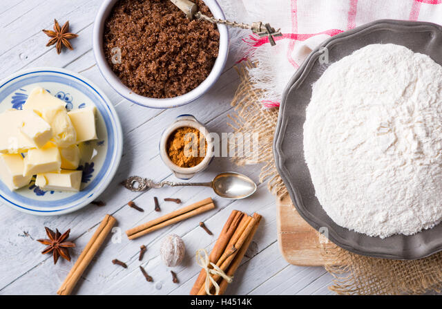 All ingredients for 'pepernoten' or 'kruidnoten', a Dutch delicacy for Dutch holiday 'Sinterklaas'. - Stock Image