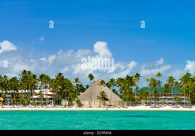 Hotels and circular beach bar along the beach at Punta Cana, Dominican Republic - Stock Image