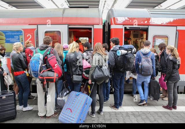 train travel europe german people vacation backpack luggage - Stock-Bilder