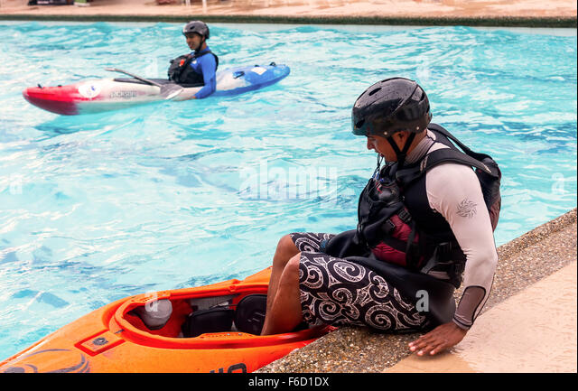 Banos, Ecuador - 23 May 2015: Unidentified Young Hispanic Guide Competes At The Canoeing Contest In A Swimming Pool - Stock Image