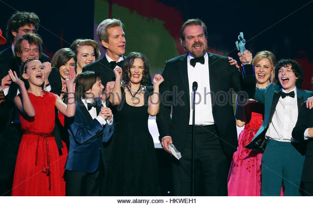The cast of Stranger Things accepts their award for Ensemble in a Drama Series during the 23rd Screen Actors Guild - Stock-Bilder