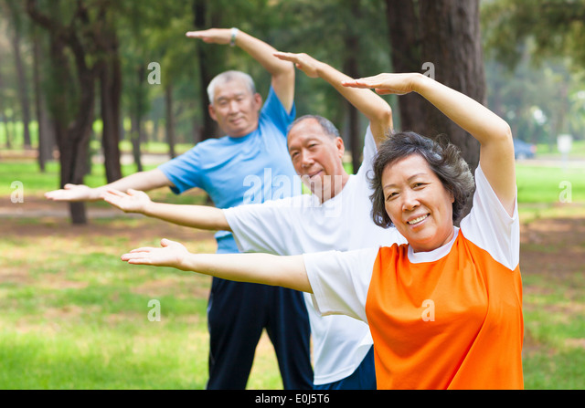 seniors doing gymnastics in the park - Stock-Bilder