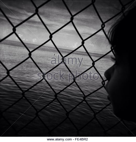 Side View Of Girl Looking At Calm Sea - Stock Image