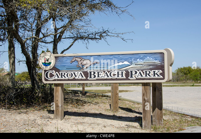 Swan Beach Park sign wild horses tourist attraction Currituck County Outer Banks North Carolina - Stock Image