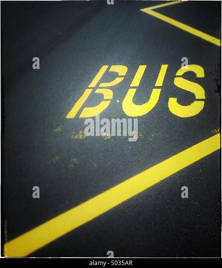 Bus stop sign painted on asphalt road in Barcelona, Catalonia, Spain - Stock Image