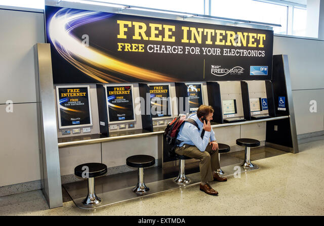 Dallas Texas Dallas Ft. Fort Worth International Airport DFW American Airlines terminal concourse free Internet - Stock Image