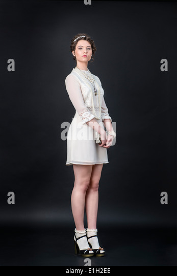 Neo-Victorian model in white dress - Stock Image
