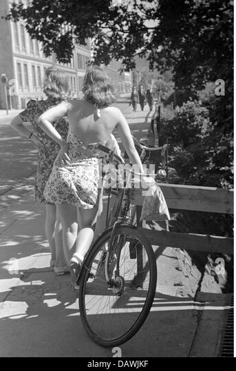 people, women, 1940s, girls in a summer dresses, July 1941, bike, bicycle, fashion, 20th century, historic, historical, - Stock Image