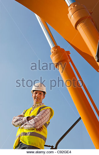 Portrait of construction worker with arms crossed - Stock-Bilder