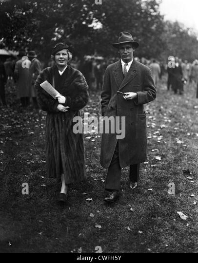 Mr and Mrs August Belmont IV,  arriving at Belmont Race Track, New York, ca 1937 - Stock Image