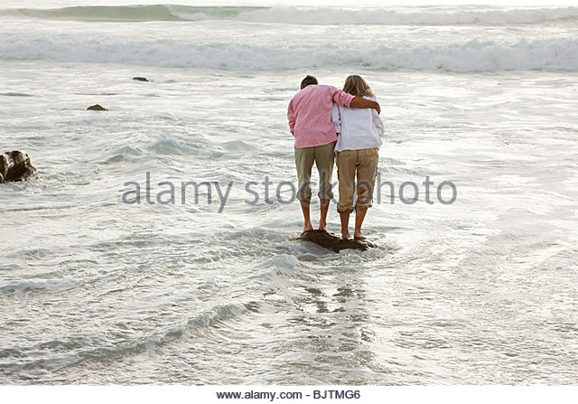 Mature couple in the sea - Stock Image