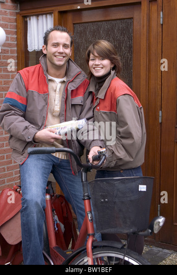Couple working together - Stock Image