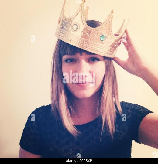 Young woman wearing crown. - Stock Image