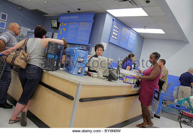 Miami Florida Wal-Mart Walmart shopping customer service desk returns Black woman - Stock Image