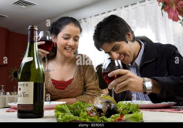 Couple enjoying a meal - Stock-Bilder