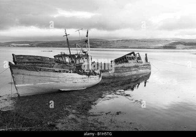 Wrecked boats on a Scottish Loch Scotland uk - Stock Image