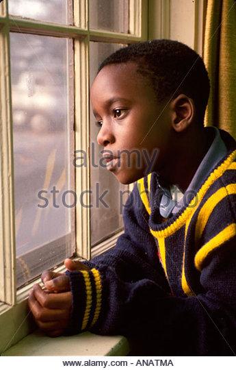 New Jersey Teaneck Black boy window looking watching - Stock Image
