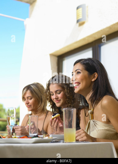 Mother with daughters celebrating - Stock Image