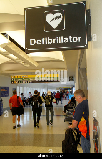 Texas Houston George Bush Intercontinental Airport IAH concourse gate area sign defibrillator heart attack - Stock Image