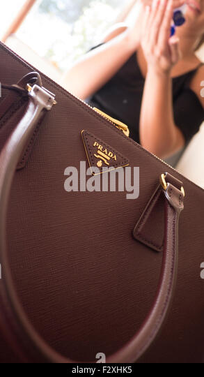 Young female with Prada bag purse handbag - Stock Image