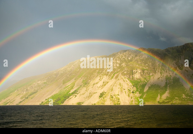 Rainbow over Wast Water looking towards the scree slopes of Illgill Head Lake District National Park Cumbria England - Stock-Bilder