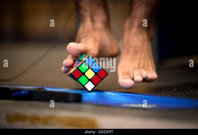 Prague, Czech Republic. 15th July, 2016. Player solves a Rubik's cube with his feet during the Rubik´s - Stock Image