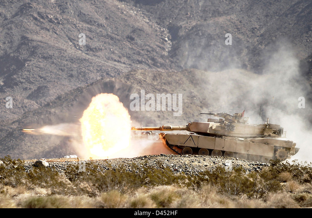 A US Army M1A2 Abrams tank fires a sabot round during annual gunnery qualifications February 17, 2013 in Twentynine - Stock Image