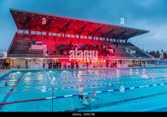 People enjoying a winter swim during the Winter lights Festival, Reykjavik, Iceland - Stock-Bilder