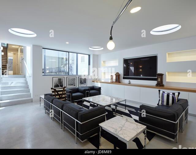 Interior view in basement with Corbusier sofa. Notting Hill House, London, United Kingdom. Architect: Michaelis - Stock-Bilder
