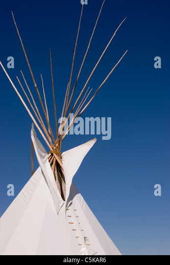 Vertical closeup of tipi top showing supporting poles - Stock Image