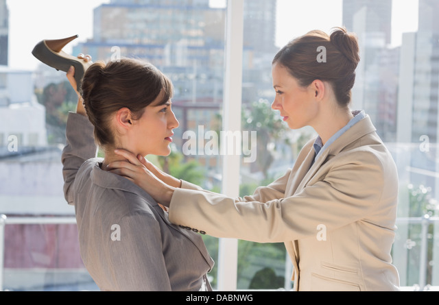 Businesswomen having a violent fight - Stock Image