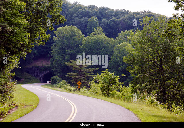Virginia Appalachian Mountains Blue Ridge Parkway All-American Road National Scenic Byway scenery trees curve yellow - Stock Image