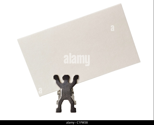 Figurine holding a piece of blank business card isolated on white background - Stock Image