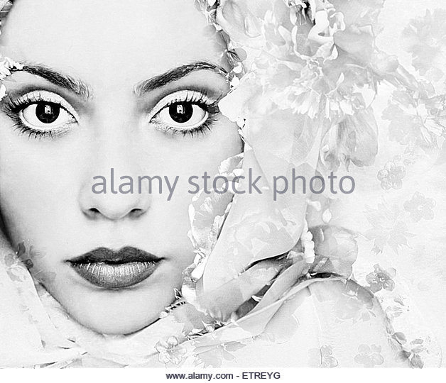 a portrait of a woman with white floral elements and big dark eyes looking into the camera, - Stock Image