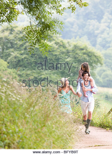 Family laughing together on lane - Stock Image