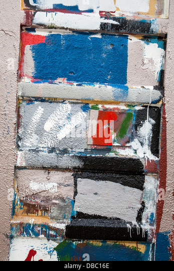 Paint daubs on painters shed _grunge paint splashes blots spatters drips drops, MacDuff Ship repairers, Scotland, - Stock Image