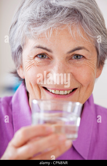 THIRSTY ELDERLY PERSON - Stock Image