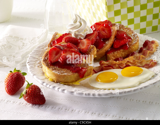 Strawberry French Toast with bacon and eggs - Stock Image