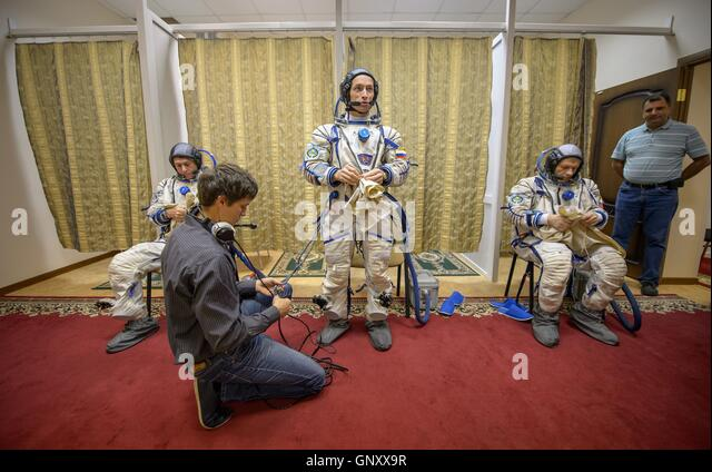 International Space Station Expedition 49-50 prime crew American astronaut Shane Kimbrough, left, Russian cosmonauts - Stock Image
