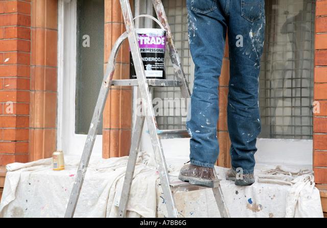 Man painting white windows - Stock-Bilder