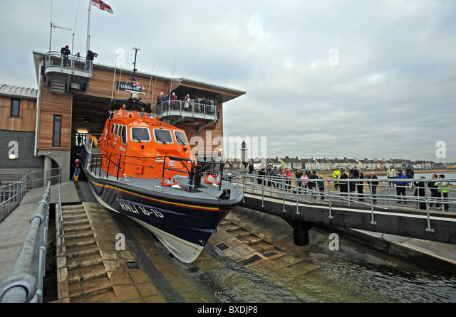The new Shoreham Harbour Lifeboat the RNLI Enid Collett arrives for the first time at the newly built lifeboat station - Stock Image