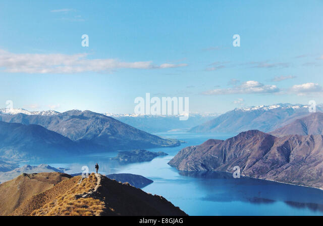 Woman standing on mountain, Canterbury, New Zealand - Stock Image