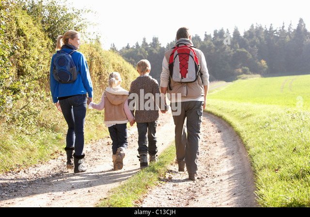 Young family walking in park - Stock Image