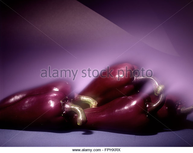 Purple peppers,food and art - Stock Image