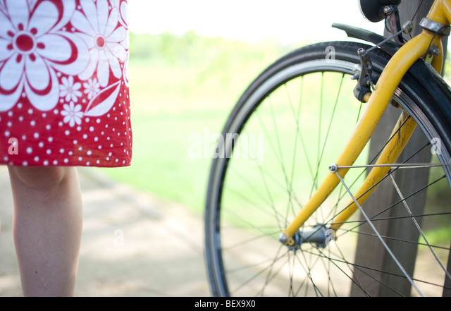 Young woman with bike - Stock Image