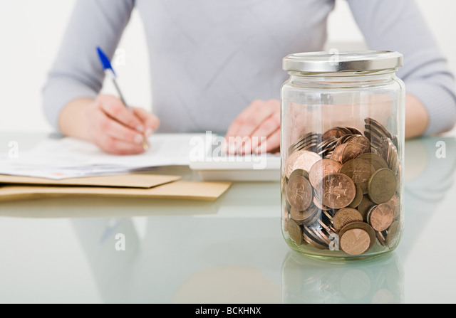 Jar of coins - Stock Image
