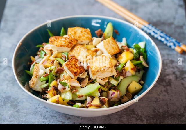 Vegan salad with tofu - Stock Image
