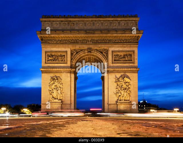 Arc de Triomphe, Paris, France at night. View from Avenue des Champs-Elysees - Stock Image