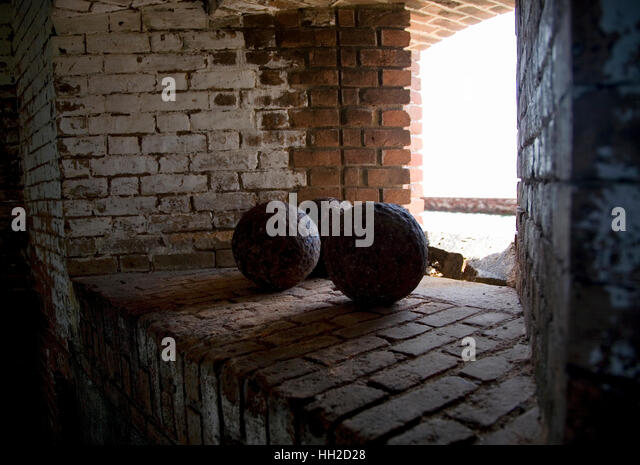 Canon balls in window light inside Fort Jefferson Dry Tortugas Florida - Stock Image